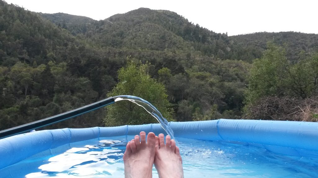 Inflatable pool carried into Tarawera Hot Springs.